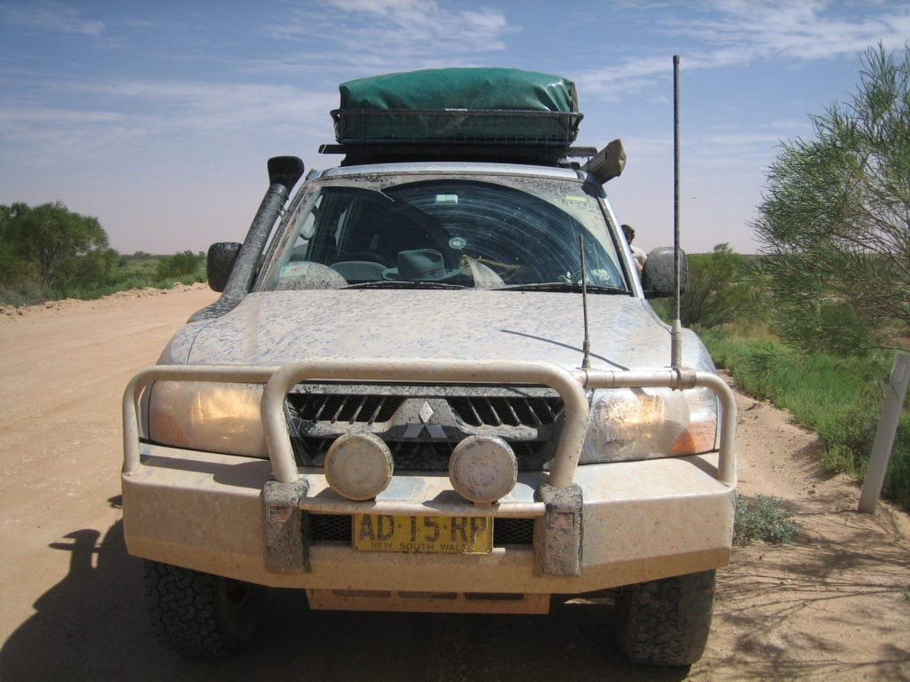 Off-Road Race Vehicle. NP Pajero covered in salty muddy water on the Oodnadatta Track