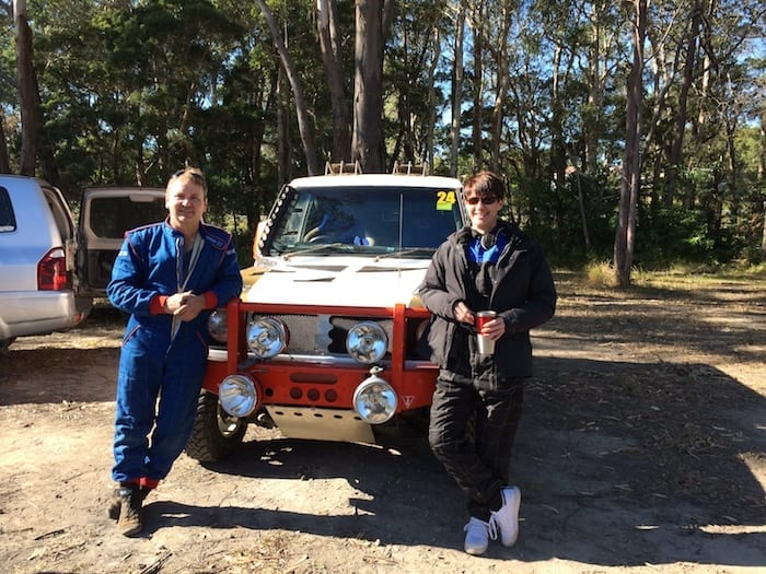 David Glazier and Peta Murray in front of Dave's Pajero cross-country race car