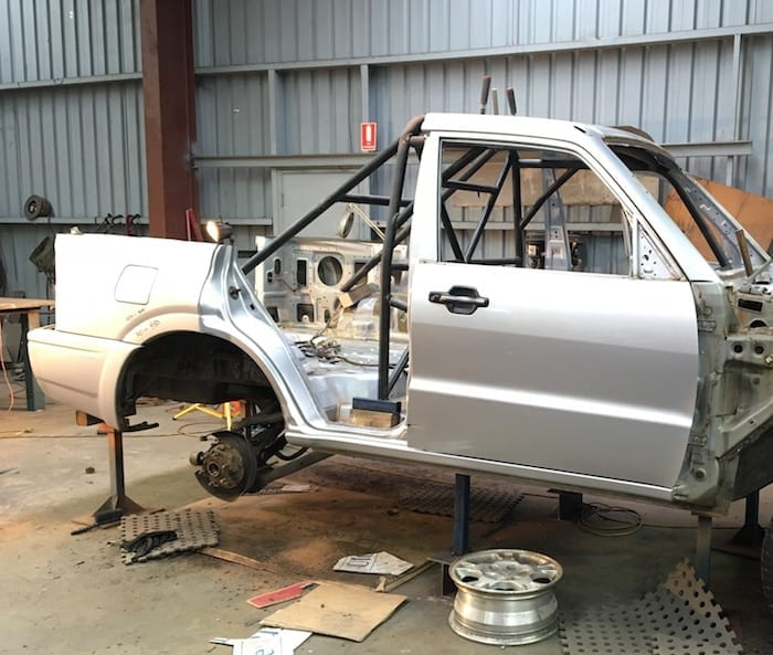 Test-fitting the roll cage in the Pajero ute