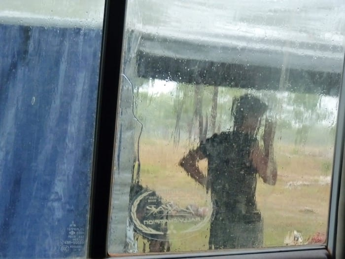 Packing down the camper trailer in pouring rain at King Edward River Campground. Kalumburu Road.