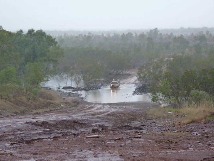 A Troopie crossing Durack River. Muddy Gibb River Road.