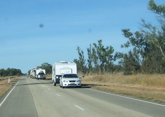 An endless procession of caravans heading North. Stuart Highway, Northern Territory. Mataranka To Tennant Creek.