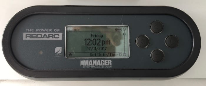 Remote monitor showing clock, REDARC Battery Management System.