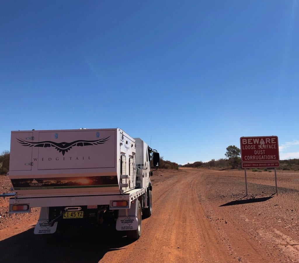 Sign warning of road conditions on Tanami track. Correct tyre pressure is critical on a road like this.