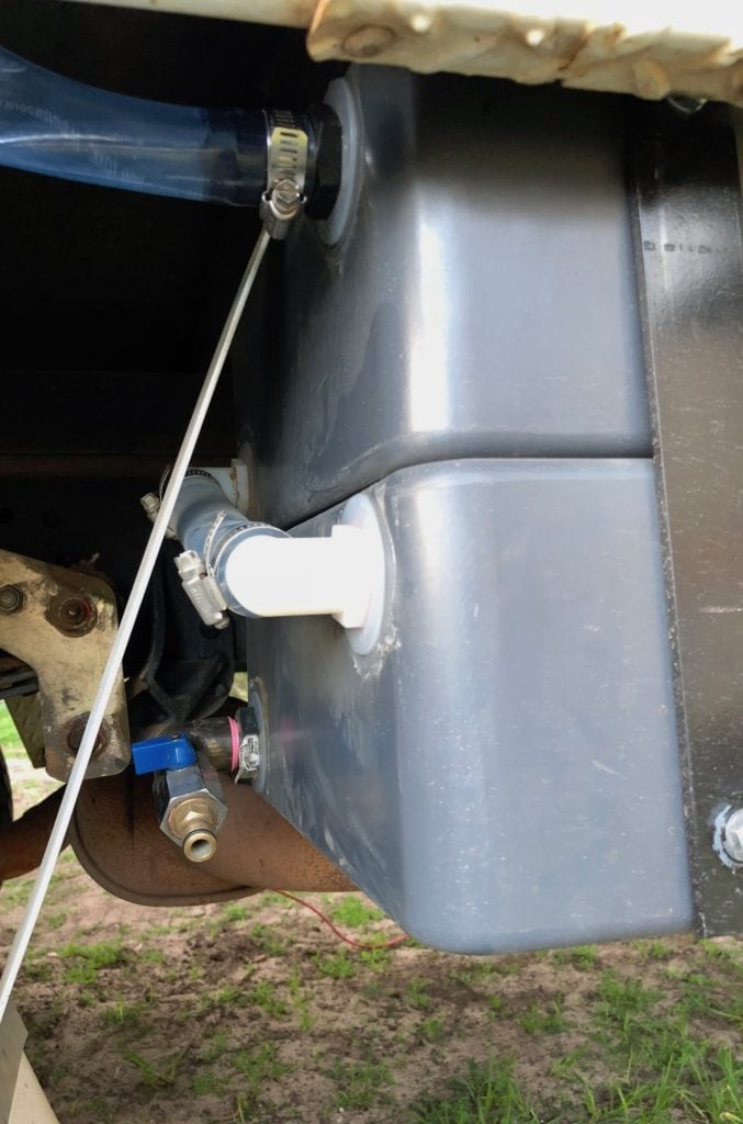 The fittings and hoses on our poly water tanks.