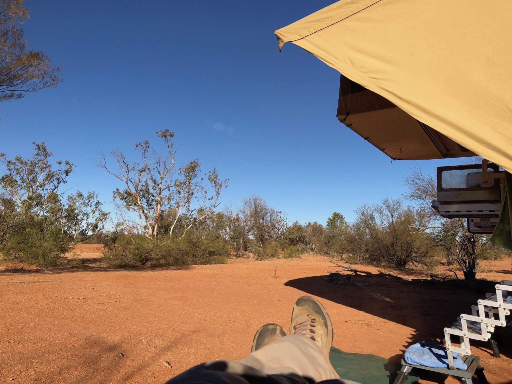 Relaxing at our bush camp near Mt Doreen ruins, Tanami Road.