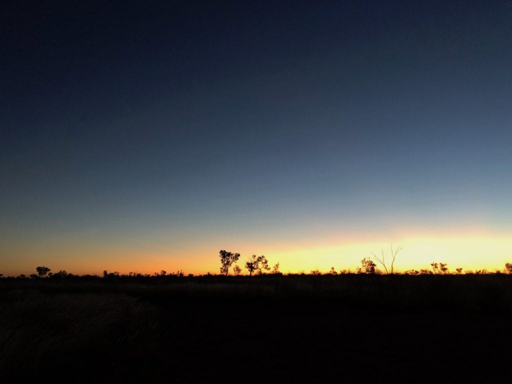 Sunset about 20km into WA on the Tanami Road.