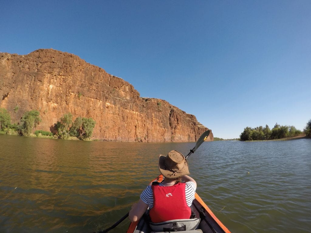 The morning sun reflecting of the cliff wall. Kayaking Carawine Gorge.