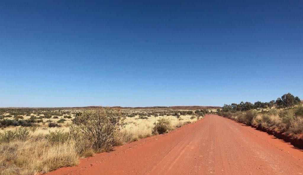 Sand dunes, spinifex and ancient mountains along Gary Junction Road.