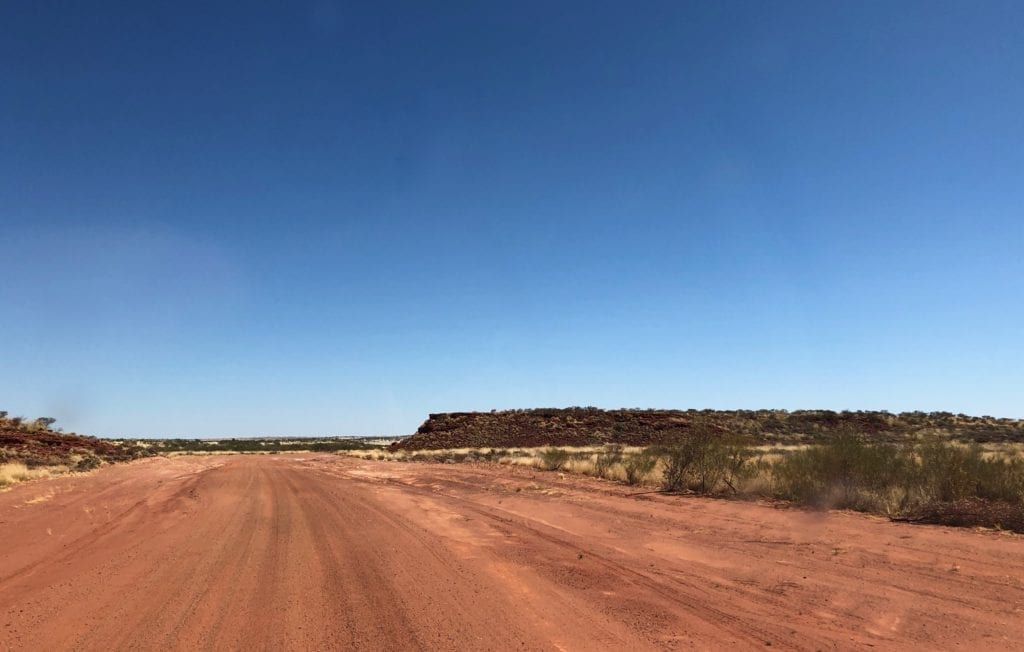 Mountains of iron ore beginning to appear as we drive west. Gary Junction To Marble Bar.