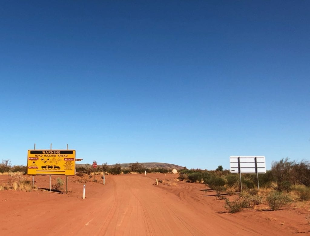 A Stop sign at Telfer Mine Road. Gary Junction To Marble Bar.