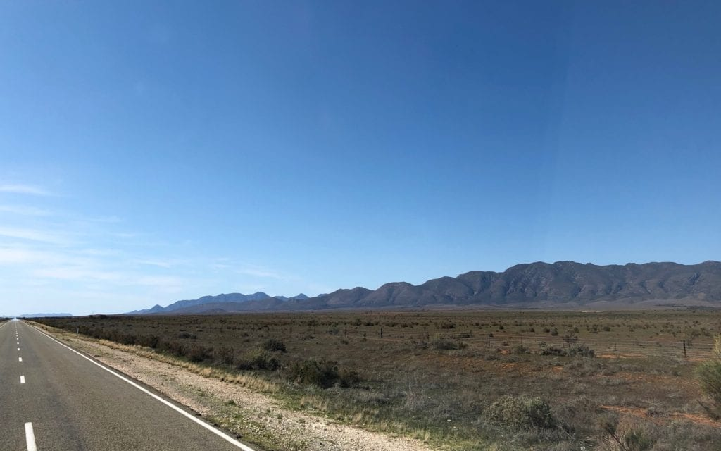 The Flinders Ranges and bluebush country, north of Quorn SA. Old Ghan rail embankment just off the road.