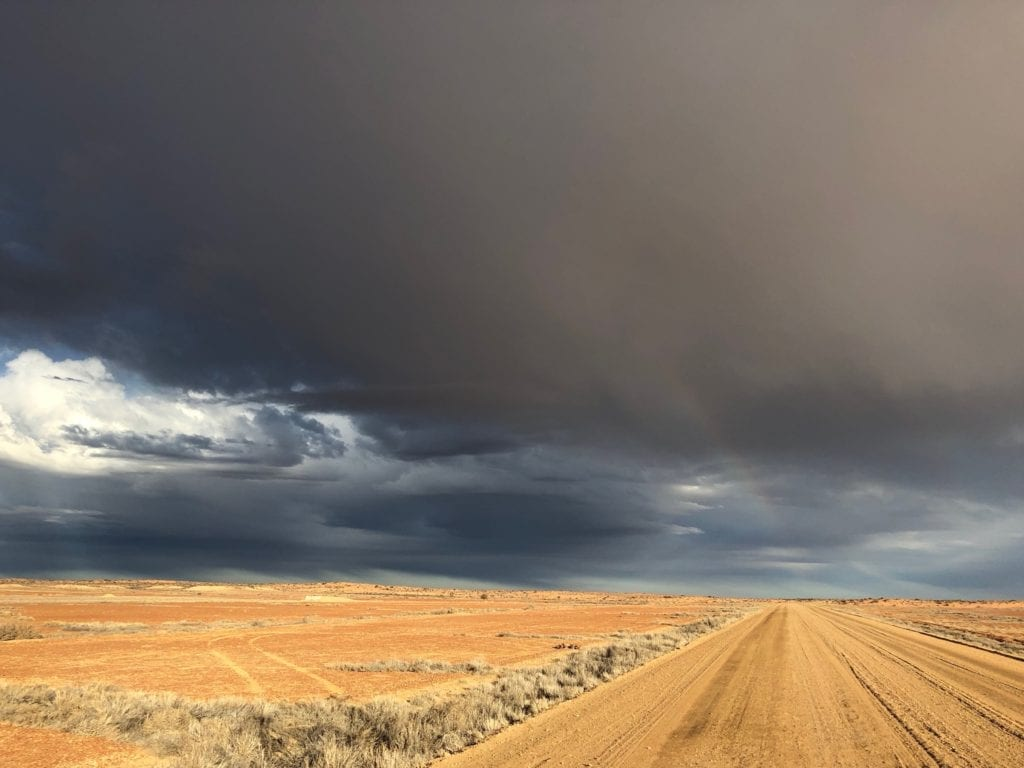 Arid country under a threatening sky. South of William Creek. Salt Lakes and Water