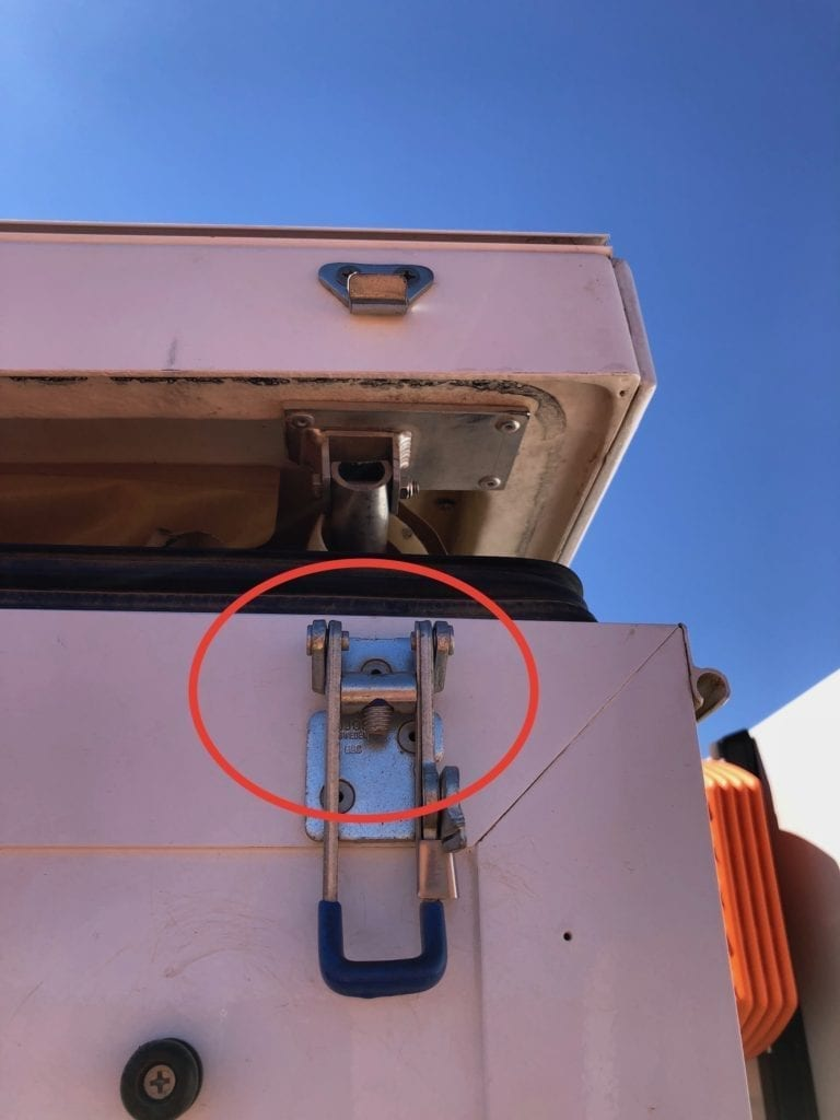 Broken latch on camper, a casualty of hours of constant slow speed pounding on the Finke track.