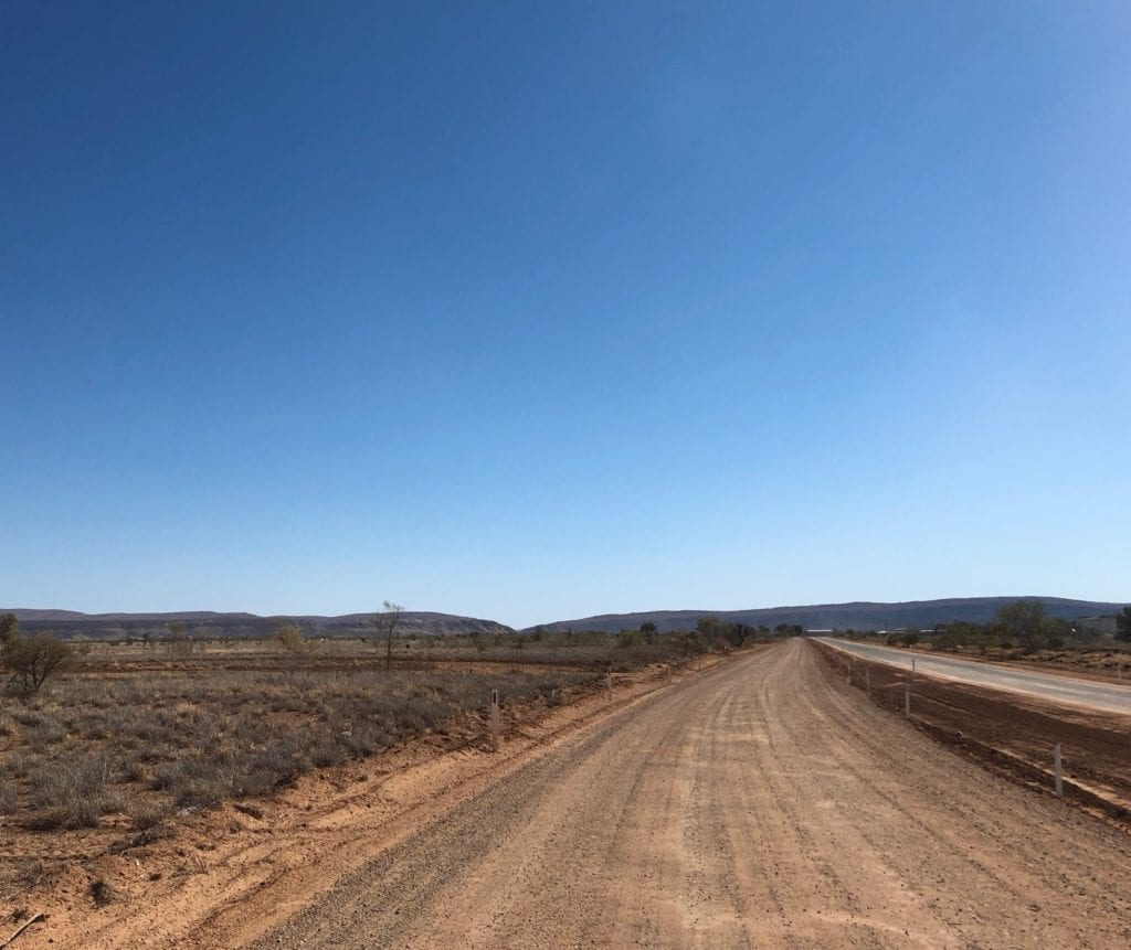 The MacDonnell Ranges are a welcome sight after driving on the Finke track.