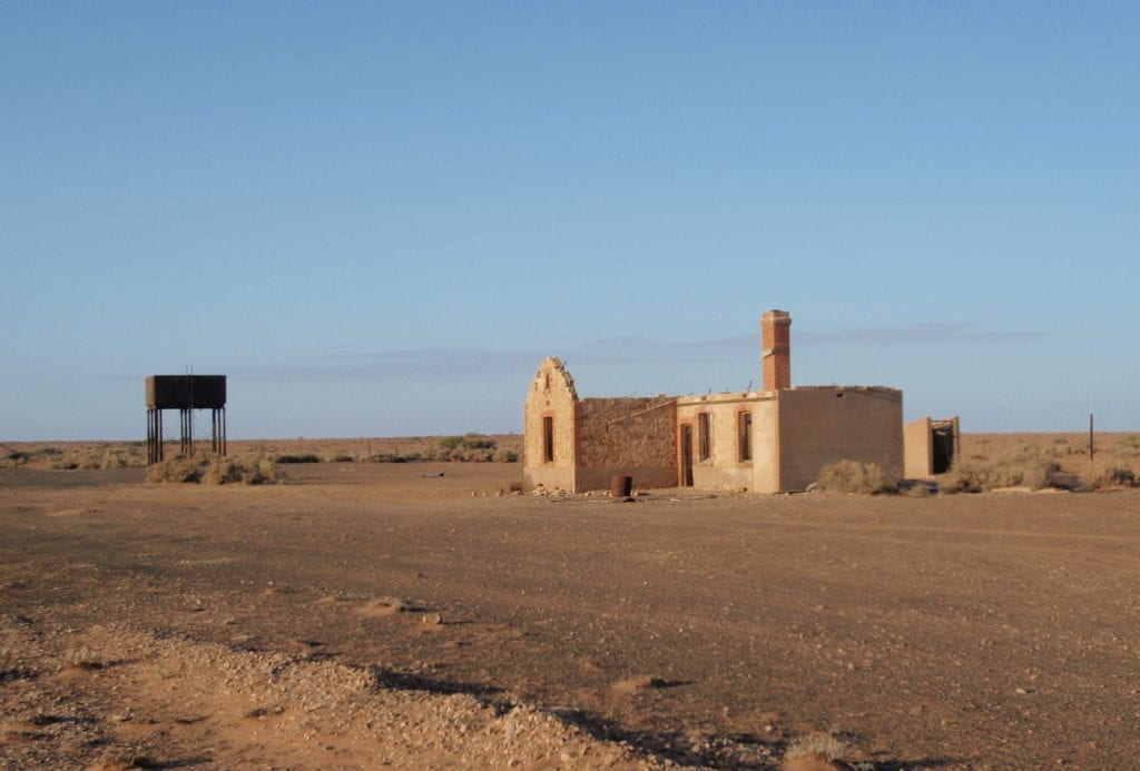 Old rail building and water tower at Farina, between Quorn SA and Marree.