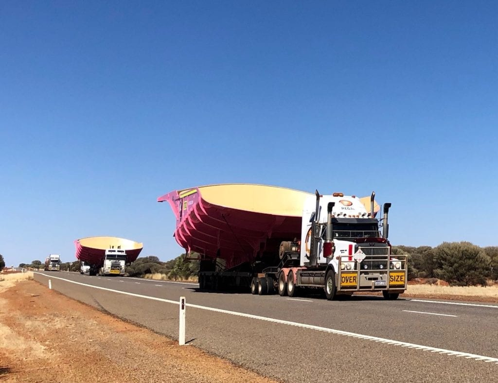 A wide load. These trucks needed both lanes of the road. Road safety.