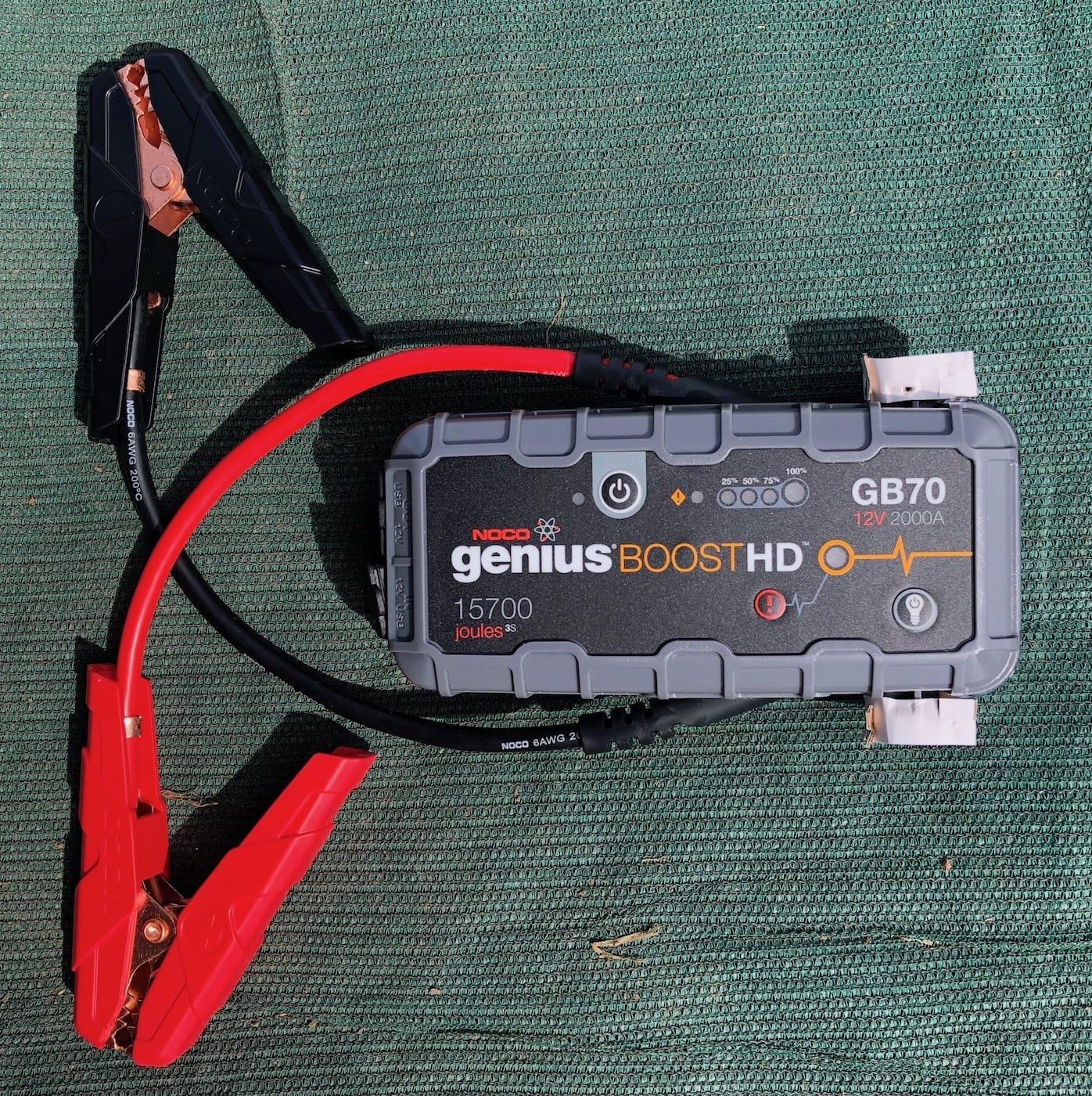 NOCO Genius Boost GB70 portable jump starter showing jaw clamps.
