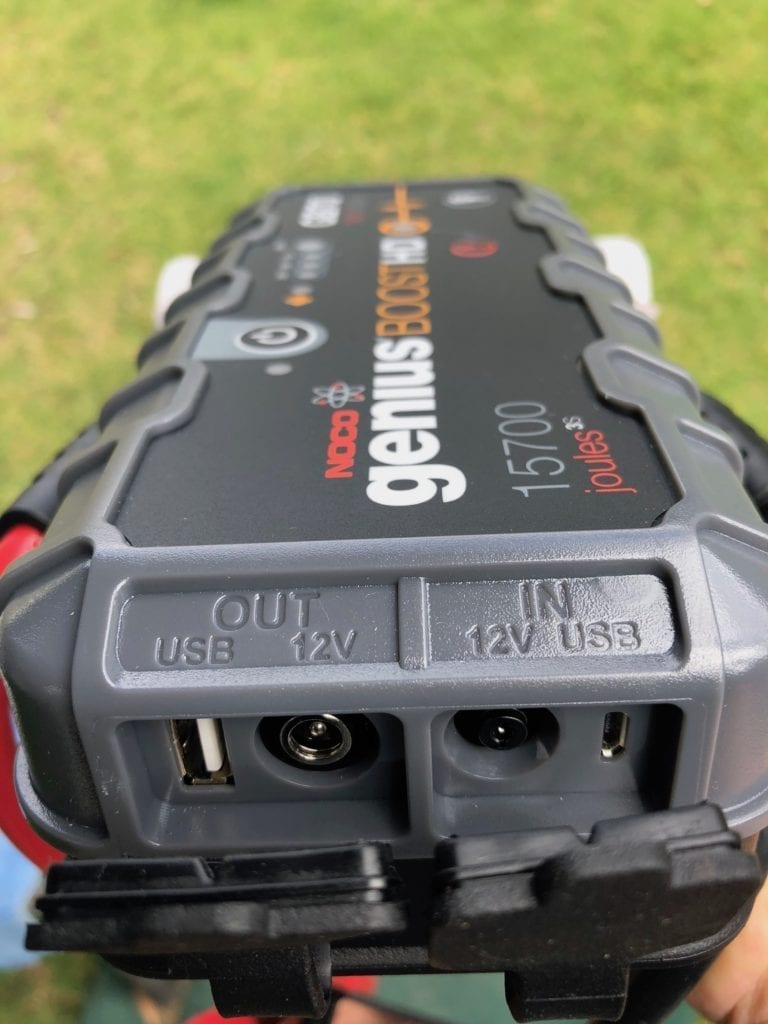 The NOCO Genius Boost GB70 portable jump starter has clearly marked input and output connections.