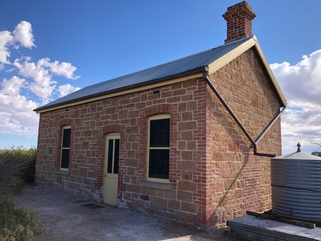 The Driver's Cottage at Coward Springs was a crumbling ruin, now an immaculate stone building.