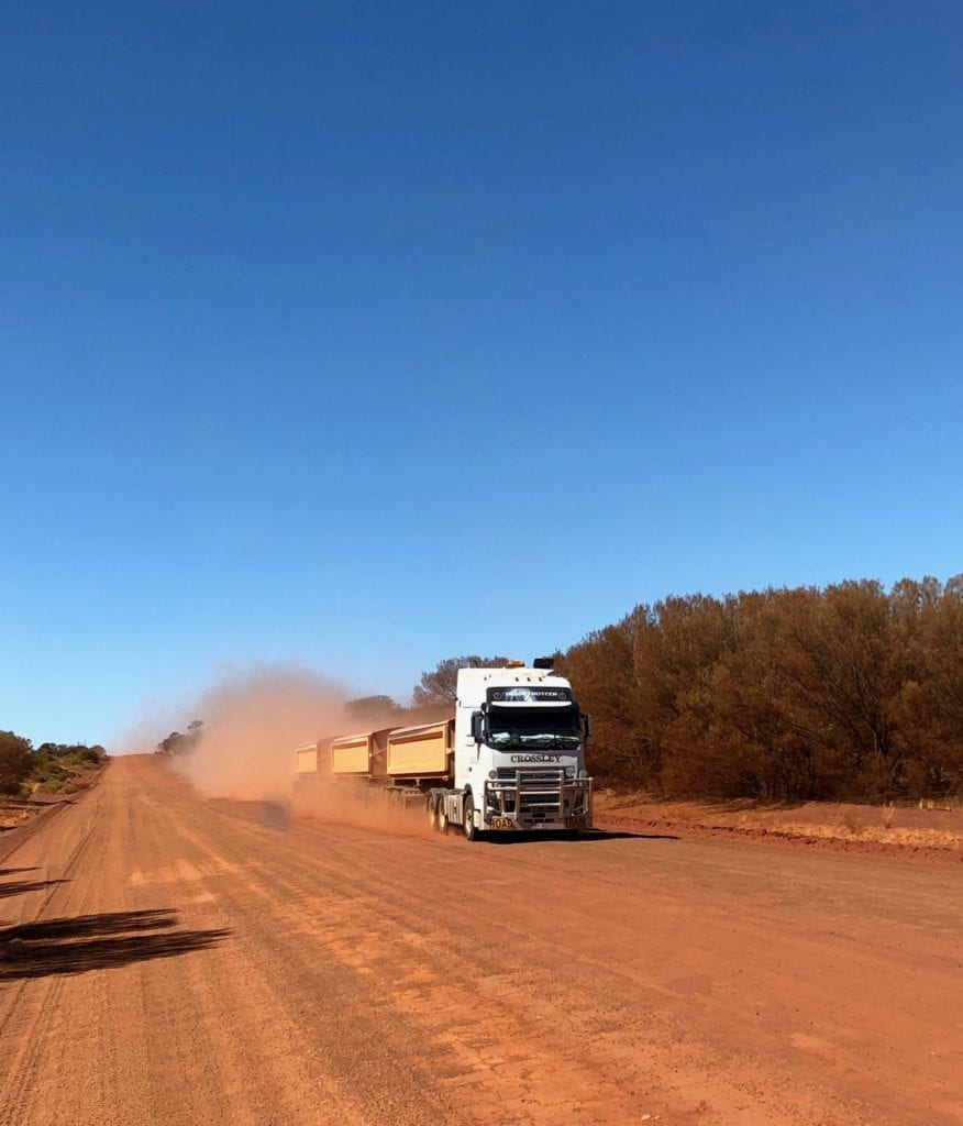 Pulling over for a triple road train on the Great Central Road.