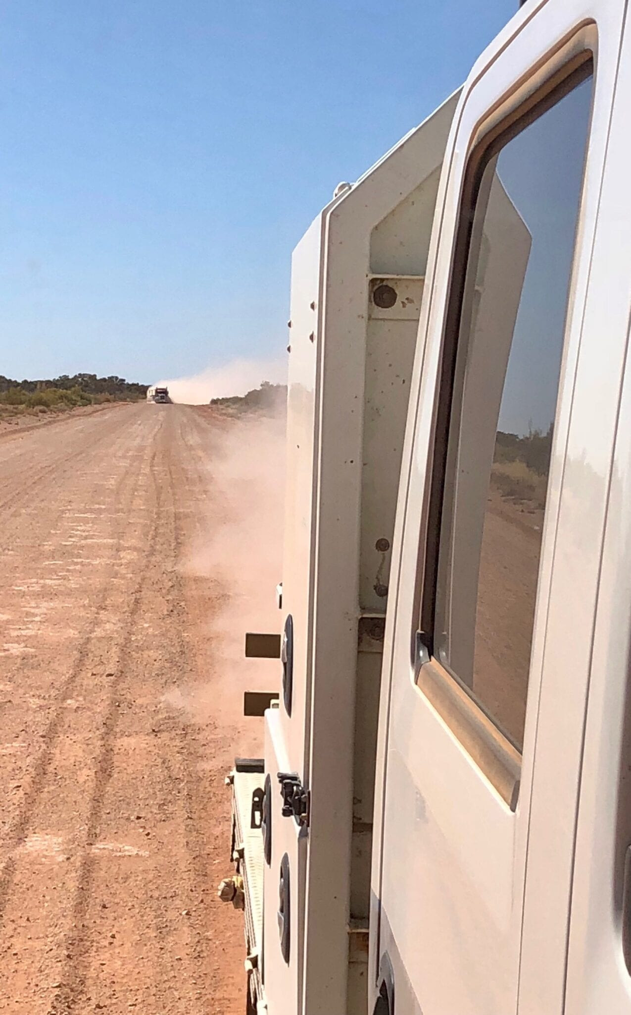 Overtaking is difficult in the thick dust. Great Central Road Condition.