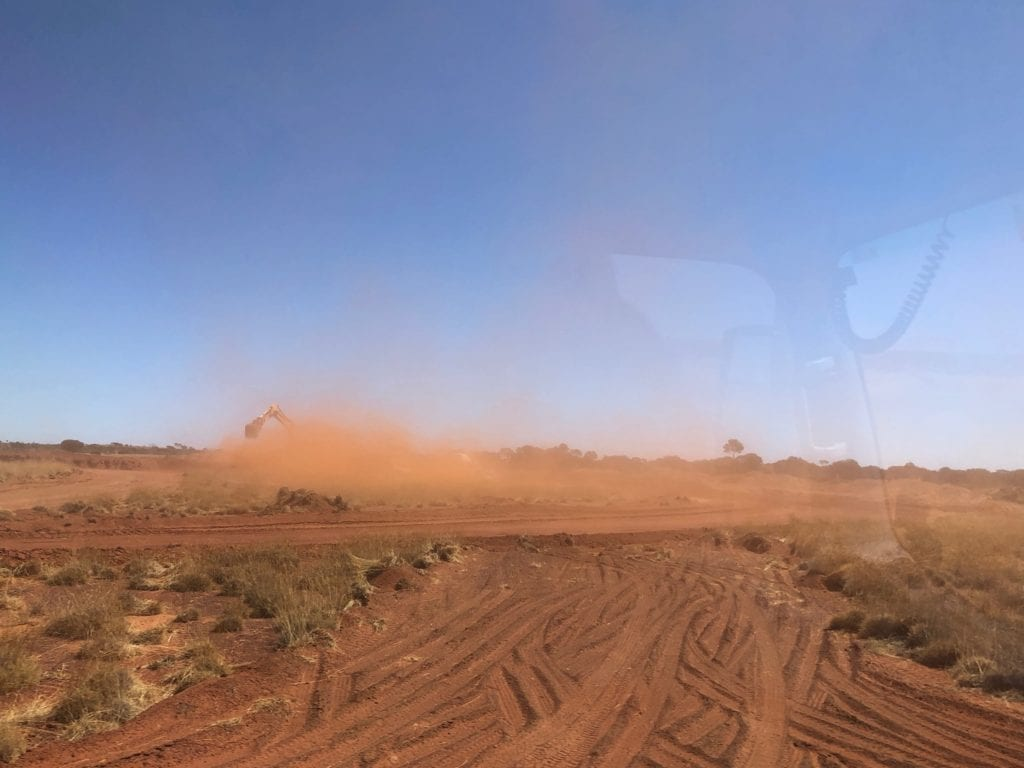 Somewhere in this dust cloud is an excavator and triple road train. Great Central Road Condition.