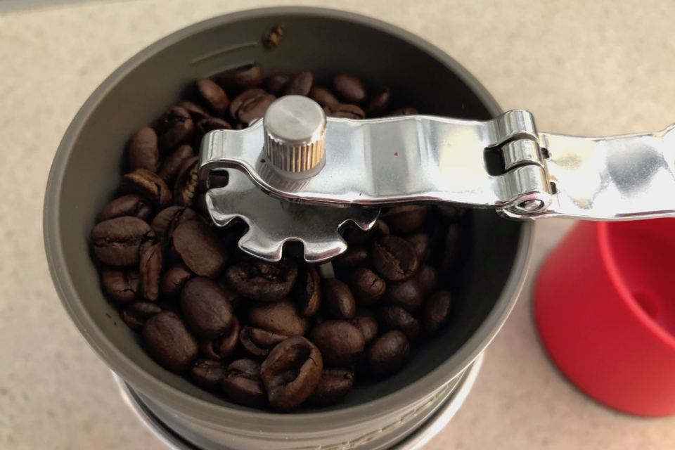 The beans in the Cafflano Klassic, ready to grind. Camping coffee maker.