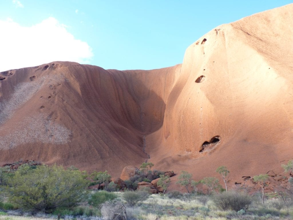 A water-stained rock gully. What Is Uluru?