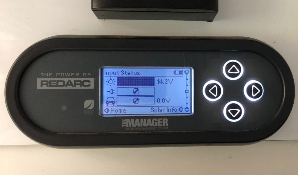 The REDARC battery monitor showing the input voltage with two solar panels connected.