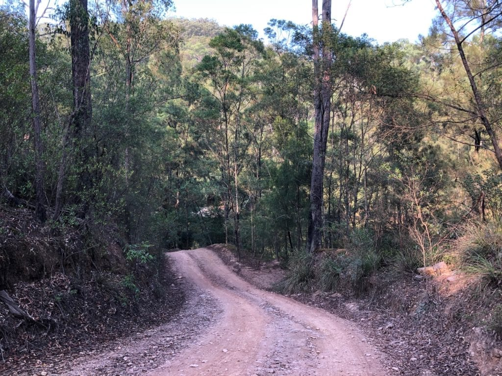 The track drops steeply down to the river at Dry Creek Camping Area. Bush camping near Canberra.