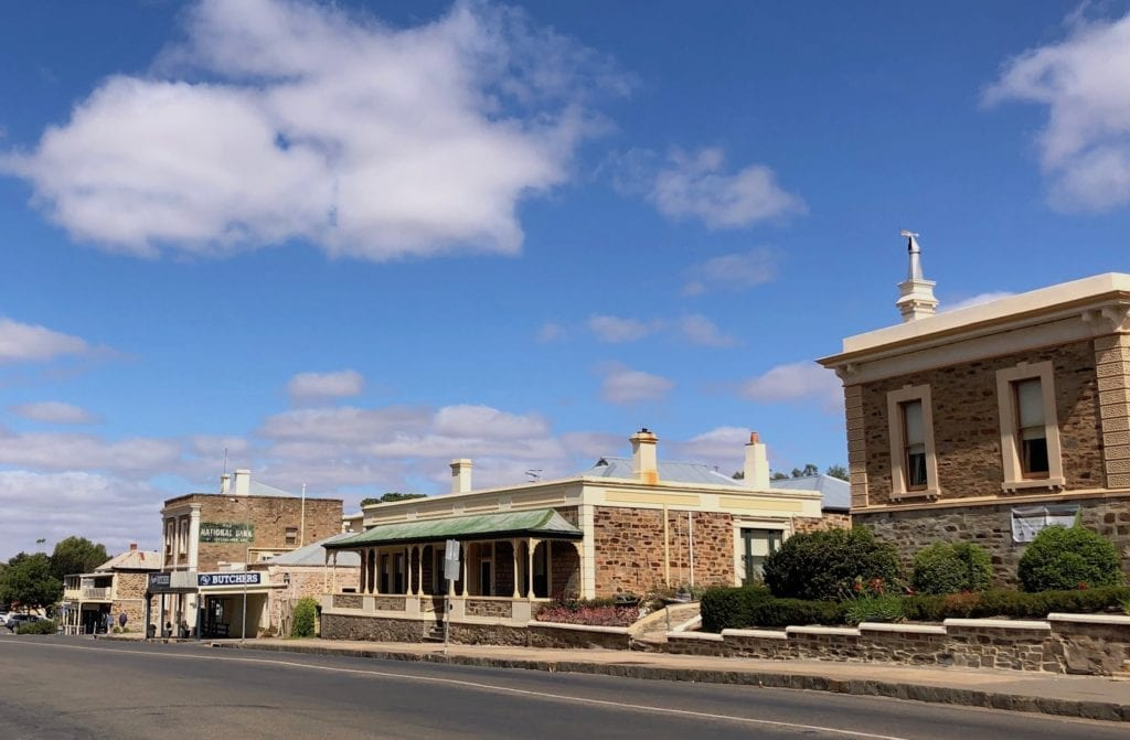 Ornate stone buildings line the main street of Burra South Australia.