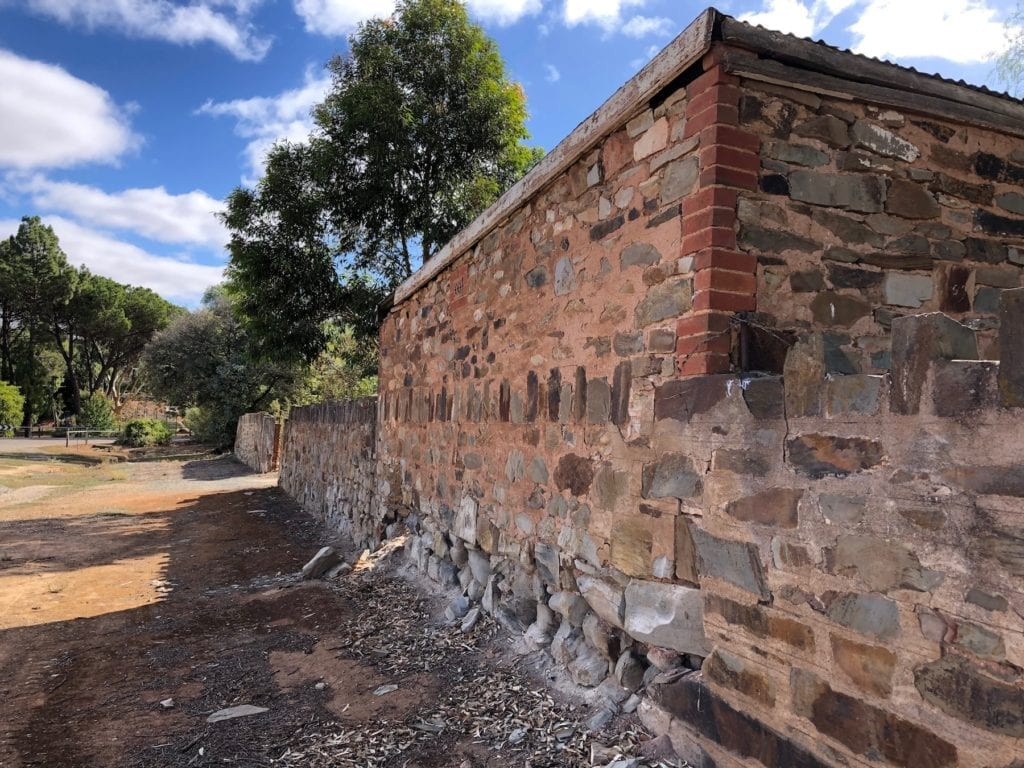An inventive homeowner has used part of the stone wall as the back wall of their garage. Burra South Australia.