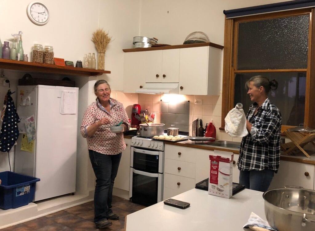 "Vicki H. working hard, cooking more of her famous ""Vicki Bikkies""."