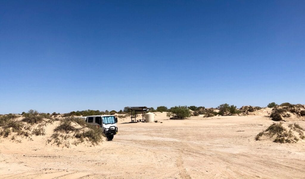 The camping area at Montecollina Bore is tucked amongst strange sand mounds.