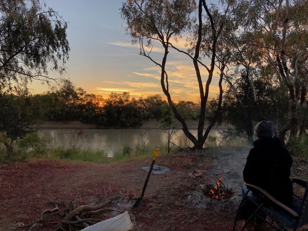 Sunset and a campfire, looking over Cooper Creek QLD.