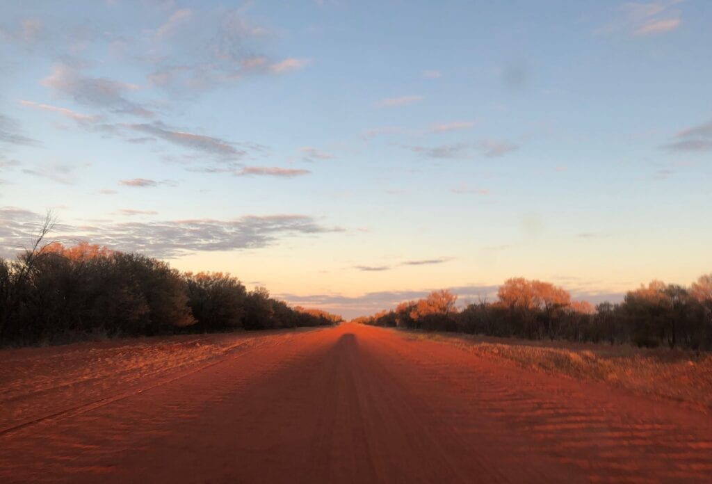 Incredible hues of red and orange as the sun rose on the Sandover Highway, NT.
