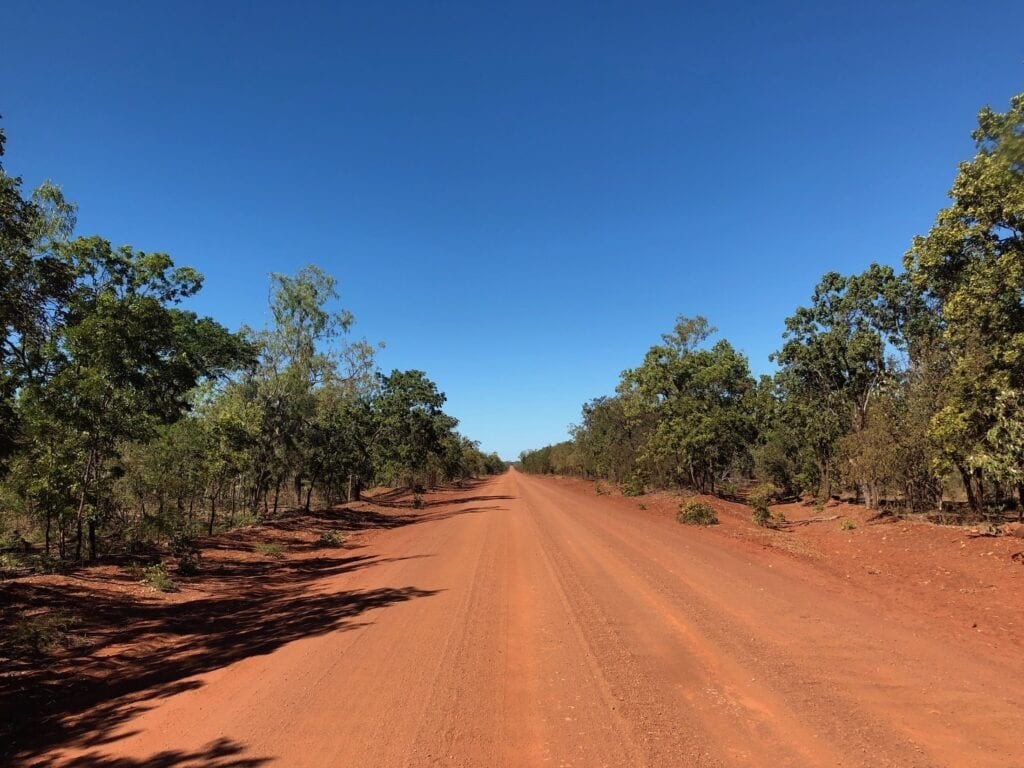 The sandy road disappears into the distance. Carpentaria Highway between Borroloola NT and Hells Gate QLD.